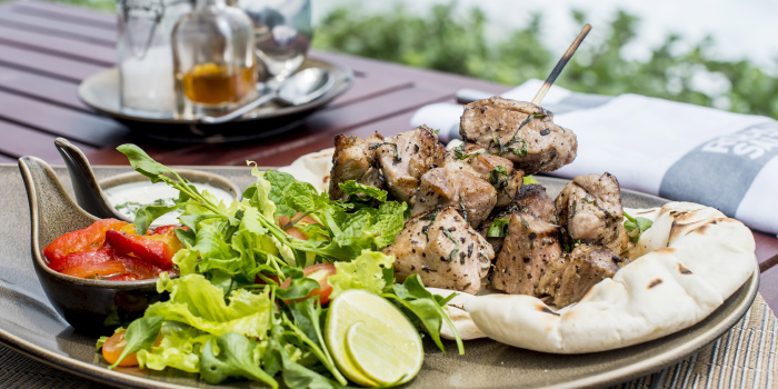 Souvlaki BBQ pork kebabs with Tzatziki, grilled peppers and pita from Rock Salt in Nai Harn, Phuket, Thailand.