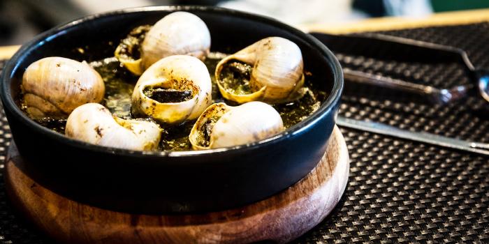 Burgundy Snails from Little Paris Phuket Restaurant in Cherngtalay, Phuket, Thailand.