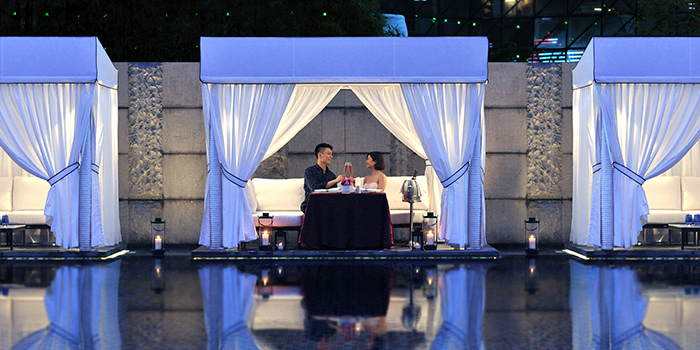 Poolside Cabanas of Pool Grill in Marriott Tang Plaza Hotel Singapore in Orchard, Singapore