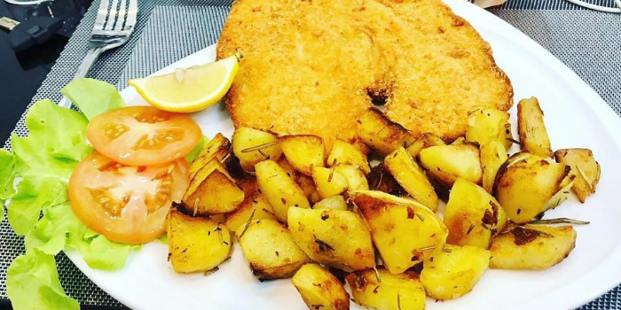 Breaded-Cutlet-with-Roasted-Potatoes from Casanova in Patong, Phuket, Thailand.