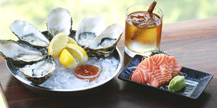 Fresh Raw Oysters and Salmon Sashimi from Tanuki Raw at Orchard Central in Orchard, Singapore