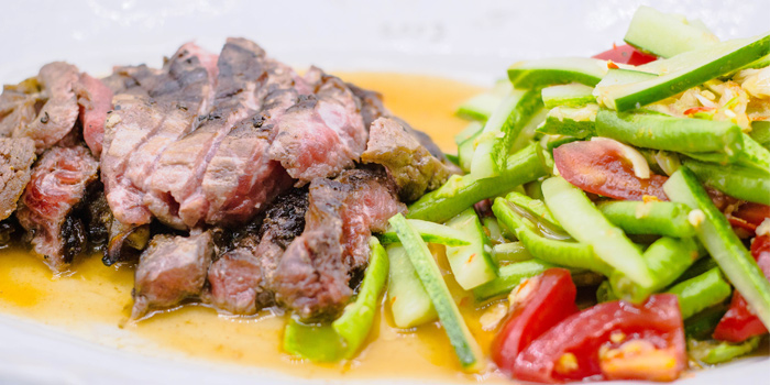 Grilled Australian Robeye Steak with Spicy Cucumber Salad from Tantitium in Phuket Town, Muang, Phuket, Thailand