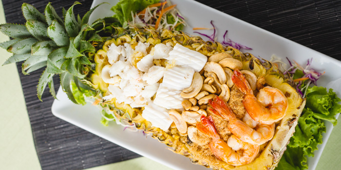 Seafood Salad in Pineapple from Ocean Best Restaurant in Patong, Phuket, Thailand.