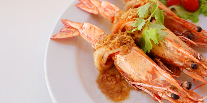 Shrimp with sauce from Ocean Best Restaurant in Patong, Phuket, Thailand.