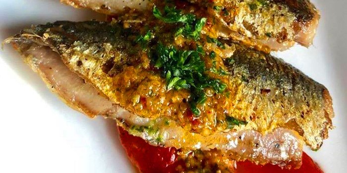 Grilled Mediterranean sardines served with roasted paprika from Taburete at 5/6 Saladaeng Road Silom,Bangrak Bangkok
