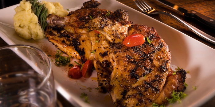 Grilled Baby Chicken Spicy from The Steakhouse & Co. at 9/8 Patpong Soi 2 Silom, Bang Rak Bangkok