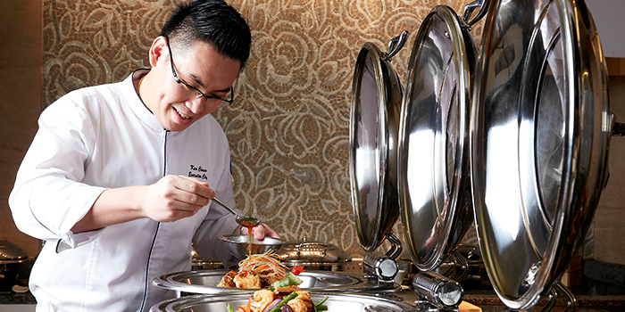 Executive Ken Chaw with Buffet Highlights from Window on the Park in Holiday Inn Singapore Orchard City Centre in Orchard, Singapore