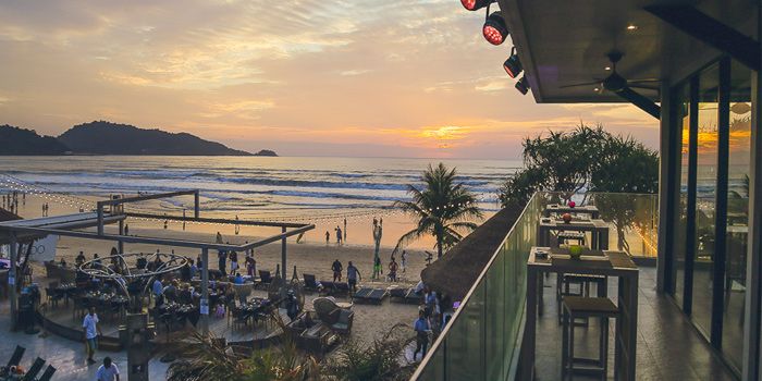 Sunset of Kudo Beach Club & Italian Restaurant in Patong, Phuket, Thailand.