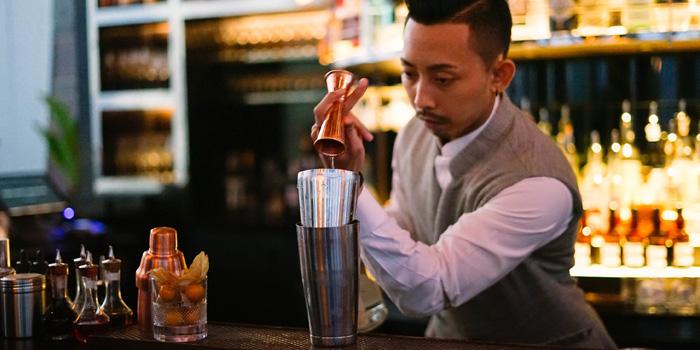 Bartender in Action from Penthouse Bar + Grill at Park Hyatt Bangkok, Bangkok