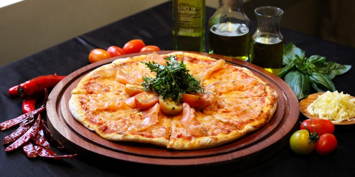 Smoked Salmon Pizza at La Vue Rooftop Bar by The Hermitage Jakarta