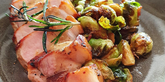 Pork Loin, Brussels Sprouts, Bacon from Frenchie Wine Bar in Outram Park, Singapore
