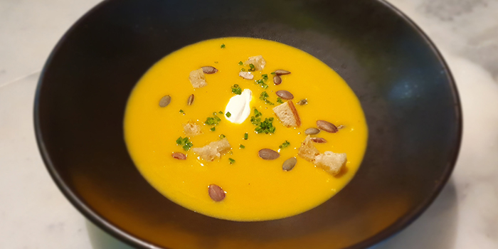 Pumpkin Soup, Garlic Croutons, Pumpkin Seed, Crème Fraiche from Frenchie Wine Bar in Outram Park, Singapore