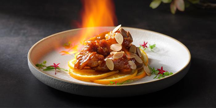 Flambe wok-fried pork ribs, citrus orange glaze, almond flakes from Man Fu Yuan in InterContinental Singapore in Bugis, Singapore