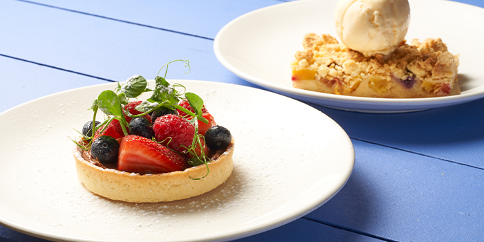Pineapple and Blueberry Crumble with Vanilla Ice Cream and Fresh Berries and Chocolate Tart from Coastes in Sentosa, Singapore